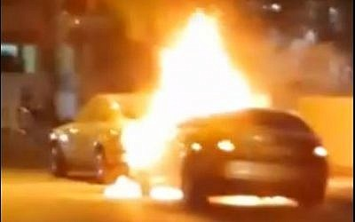 Unverified image of Oren Saudai's car after it was attacked with a Molotov Cocktail. (screen capture: Youtube/Omer Media)
