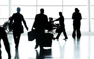 Business travelers ( Business travelers via Shutterstock)