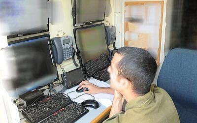 An IDF C4I Corps soldier monitors for hacker activity (Photo credit: Courtesy)