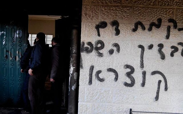 "Graffiti reading ""We will avenge your spilled blood, Qusra"" on the walls of a mosque that was set ablaze in an apparent ""price tag"" attack in the Palestinian village of Deir Istiya in January 2014. (photo credit: Zakariya/Rabbis for Human Rights)"