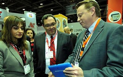 Education Minister Director Michal Cohen (L.) and Education Minister Shai Piron (C.) look on as Fourier CEO Ken Zwiebel demonstrates an Einstein tablet+ at the Bett Show in London last week (Photo credit: Courtesy)