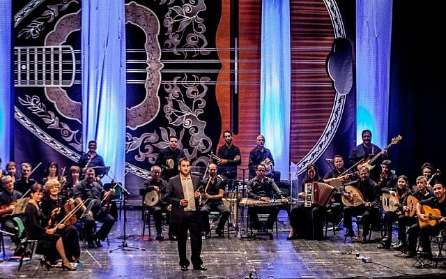 Conductor Tom Cohen and the Ashkelon Andalusian-Mediterranean Orchestra (photo credit: Yoram Blumenkrantz)
