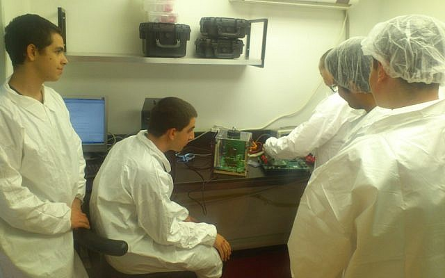 Students work on the Duchifat cubesat (Photo credit: Courtesy)