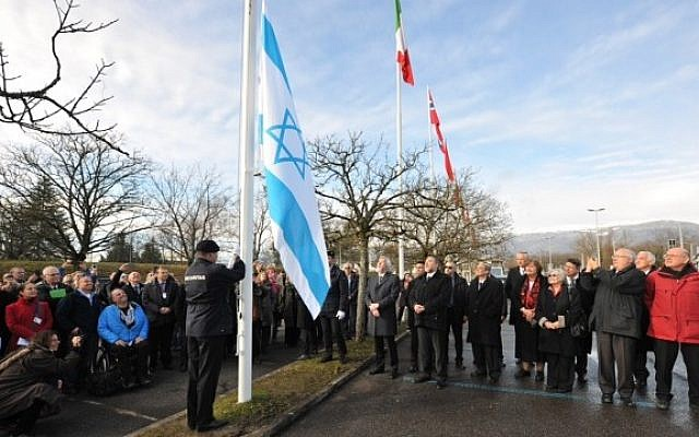The Israeli flag is raised during a ceremony marking Israel's entrance into the European Organization for Nuclear Research, Wednesday, January 15, 2014 (photo credit: Laurent Egli)