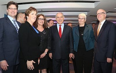 (R. to L.):  Bob Eastman, President Global Solutions at Lockheed Martin; Dr. Orna Berry, Director of EMC Israel; Prime Minister Binyamin Netanyahu; Professor Rivka Carmi, President of Ben Gurion University;  Chandra McMahon, Senior VP Commercial Markets, Lockheed Martin IS&GS; and Dr. John Evans, Vice President Business Innovation for Lockheed Martin Corporation, at the signing ceremony of the cooperation agreement between Lockheed-Martin, EMC, and Ben-Gurion University (Photo credit: Courtesy)