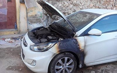 A car burned in an apparent 'price tag' attack in the Palestinian village of Madama, in the northern West Bank, January 8, 2014. (photo credit: Rabbis For Human Rights)