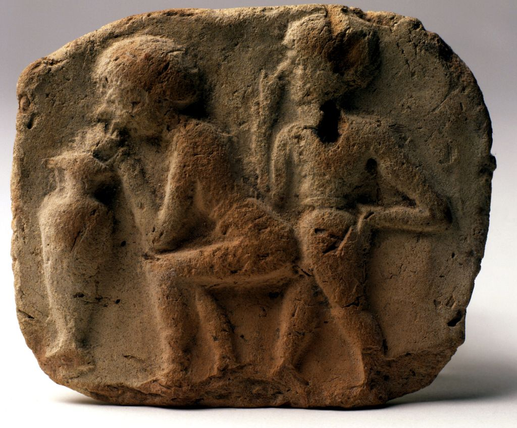 An Old Babylonian clay plaque on display at The Israel Museum showing a couple having sex. (photo credit: The Israel Museum)