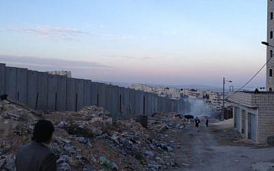 A view from Ras Khamis towards the Jewish neighborhood of Pisgat Ze'ev (photo credit: Elhanan Miller/Times of Israel)
