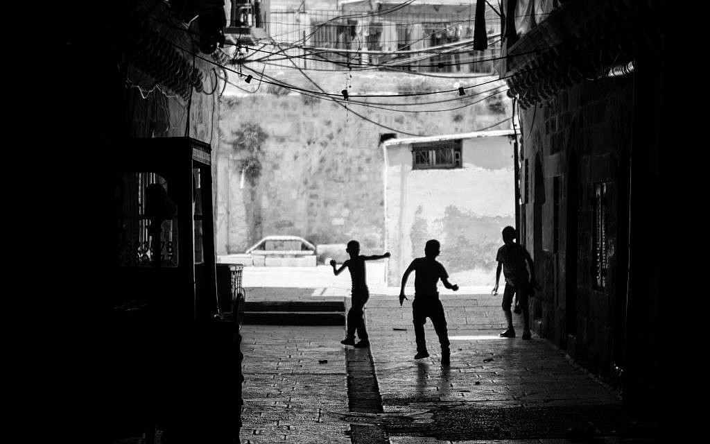 The Best in Show winner. Derek Doneen snapped this photo, 'The Youth,' while walking through Jerusalem's Old City. 'I can't pin down what exactly inspired the photo. To me, photography is an immediate reaction. I'm more interested in capturing real, human moments than I am in setting up posed pictures. Photographs are fractions of seconds. I was so humbled walking through the Old City and thinking about the history surrounding me -- how much this particular area means so much to so many people. It's been a place of tremendous loss and horrific conflict and yet, brought immense joy to so  many others. Here are three kids playing in an ally -- oblivious to all of that. They could be Israeli or Palestinian, maybe both. It doesn't matter. There's innocence and purity that comes along with being a child that's captured in this picture.' (photo credit: Derek Doneen)