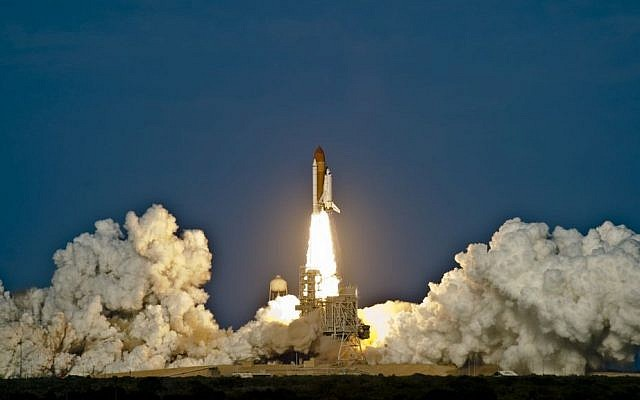 The NASA space shuttle Discovery lifts off from the Kennedy Space Center in 2011. (photo credit: NASA)