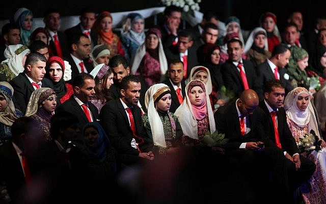 Palestinian couples on January 28, 2014, during a mass wedding ceremony in the West bank city of Jericho (photo credit: AFP/Abbas Momani)