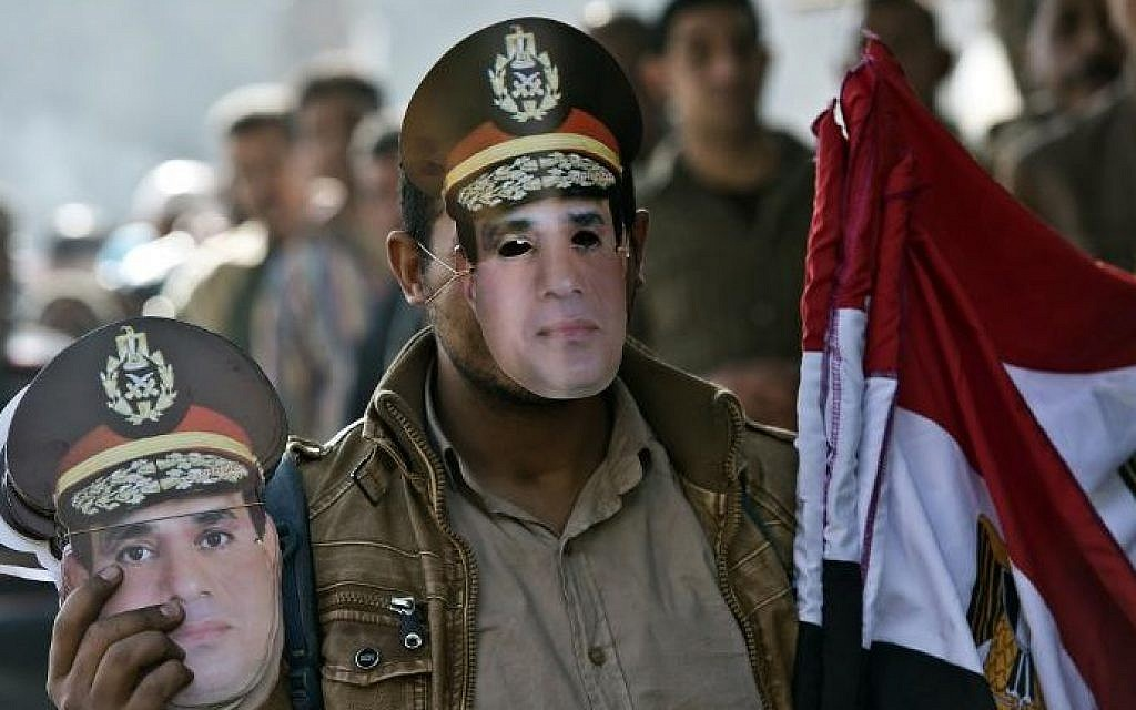 An Egyptian street vendor sells masks of Abdel-Fattah el-Sissi in Cairo, January 15, 2014. (photo credit: Khaled Desouki/AFP)