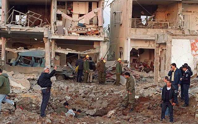An apartment bloc in ruins after an Iraqi Scud missile attack in Tel Aviv, on Friday, Jan. 18, 1991. The Iraqi missile attack came one day after U.S. forces launched Operation Desert Storm - the Gulf War - against Iraq. (photo credit: AP Photo/Martin Cleaver)