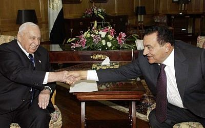 Prime minister Ariel Sharon, left, and Egyptian President Hosni Mubarak shake hands during a meeting at the Red Sea resort of Sharm el-Sheik, Egypt, Tuesday Feb. 8, 2005. (photo credit: AP Photo/Avi Ohayon/Government Press Office)