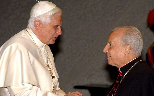 Pope Benedict XVI, left, salutes Monsignor Javier Echevarria Rodriguez, the head of the conservative Roman Catholic movement Opus Dei, during an audience with youths of Opus Dei, in the Paul VI hall at the Vatican, Monday April 10, 2006 (photo credit: AP)