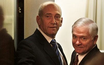 Prime Minister Ehud Olmert, left, and US defense secretary Robert Gates arrive for a meeting at the Prime Minister's Office in Jerusalem, Thursday, April 19, 2007.  (photo credit: AP Photo/Kevin Frayer)