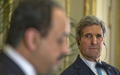 US Secretary of State John Kerry, right, listens to Qatar's Foreign Minister Khalid al-Attiyah, left, during their joint news conference at the US Ambassador's residence in Paris, France, Sunday, Jan. 12, 2014 (photo credit: AP/Pablo Martinez)