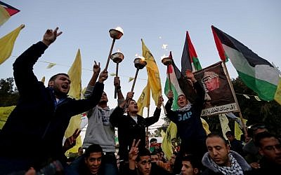 Fatah supporters celebrate in Gaza on the 49th anniversary of the movement's foundation, December 31, 2013 (photo credit: AP/Hatem Moussa)