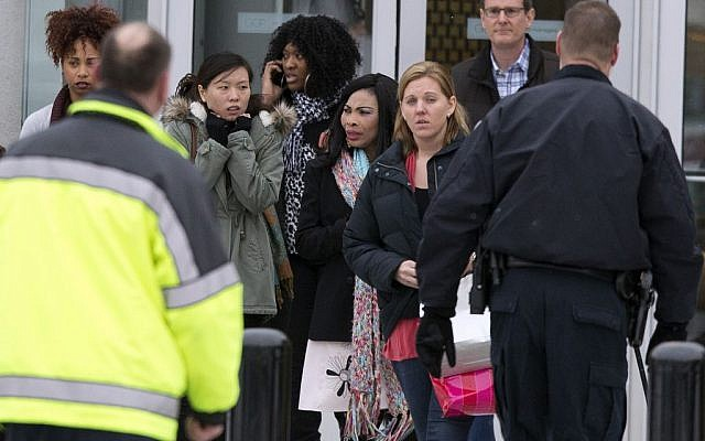 Shoppers are evacuated by police and rescue personnel after a shooting at the Mall in Columbia on Saturday, Jan. 25, 2014 in Columbia, Md. Police say three people died in a shooting at the mall in suburban Baltimore, including the presumed gunman. (photo credit: AP/Evan Vucci)