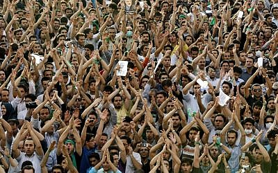 In this Monday, June 15, 2009 file photo, hundreds of thousands of supporters of leading opposition presidential candidate Mir Hossein Mousavi, who claims there was voting fraud in Friday's election, turn out to protest the result of the election at a mass rally in Azadi (Freedom) square in Tehran, Iran. (photo credit: AP Photo/Ben Curtis, File)