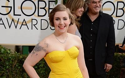 Lena Dunham arrives at the 71st annual Golden Globe Awards at the Beverly Hilton Hotel on Sunday, Jan. 12, 2014, in Beverly Hills, Calif. (Jordan Strauss/Invision/AP)