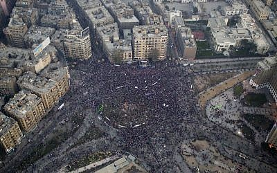 This aerial image made from an Egyptian army helicopter shows a general view of a pro-military rally marking the third anniversary of the uprising that toppled autocrat Hosni Mubarak in Tahrir Square in Cairo, Egypt, Saturday, Jan. 25, 2014. (photo credit: AP/Hassan Ammar)