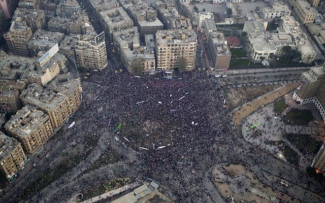 This aerial image made from an Egyptian army helicopter shows a general view of a pro-military rally marking the third anniversary of the uprising that toppled autocrat Hosni Mubarak in Tahrir Square in Cairo, Egypt, January 25, 2014. (AP/Hassan Ammar)