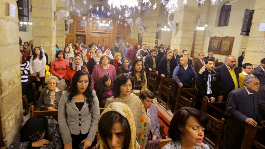 Coptic Christians celebrate Christmas Eve at Cairo's Church of the Virgin Mary, on Monday (photo credit: AP/Amr Nabil)