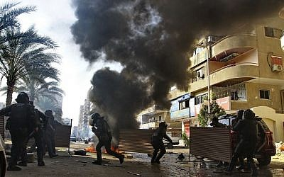 Egyptian security forces clash with supporters of ousted president Mohammed Morsi in the Nasr City district of Cairo, Egypt, January 10, 2014 (photo credit: AP/Ahmed Abd El Latif, El Shouk newspaper)