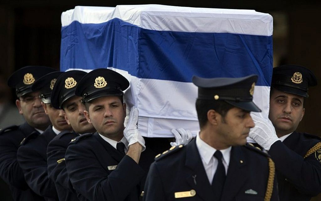 Members of the Knesset guard carry the coffin of Ariel Sharon outside the Knesset in Jerusalem, Monday, January 13, 2014 (photo credit: AP/Bernat Armangue)