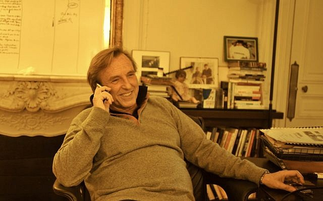 Alexandre Arcady, one of France's best-known directors, is making a feature film about the 2006 murder of Ilan Halimi. Arcady is pictured here in his Paris office. (Cnaan Liphshiz/JTA)