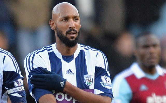 French soccer star Nicolas Anelka performing the quenelle, a Nazi-like salute, after scoring a goal at a match in London, December 28, 2013. (photo credit: Christopher Lee/Getty Images/via JTA)