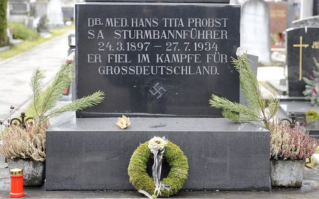 This picture taken Tuesday, Jan. 21, 2014 shows a marble tombstone which is adorned by a swastika and the inscription 'He died in the struggle for a Great Germany' at the central cemetery in Graz, Austria. (AP Photo/Hans Punz)