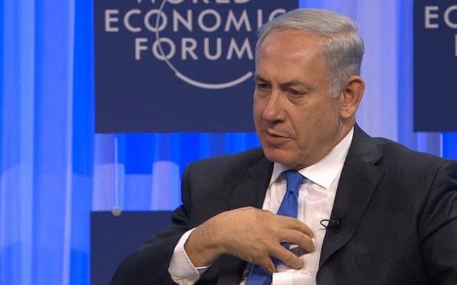 Prime Minister Benjamin Netanyahu gestures during a Q&A session at the World Economic Forum's annual meeting in Davos, Switzerland, Thursday, January 23, 2013 (screen capture)