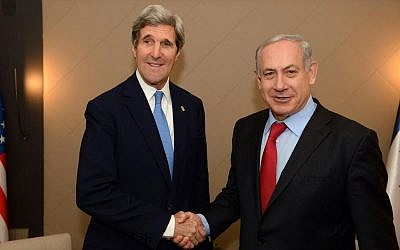 US Secretary of State John Kerry and Prime Minister Benjamin Netanyahu shake hands during their meeting on the sidelines of the World Economic Forum in Davos, Switzerland on January 24, 2014. (PMO)