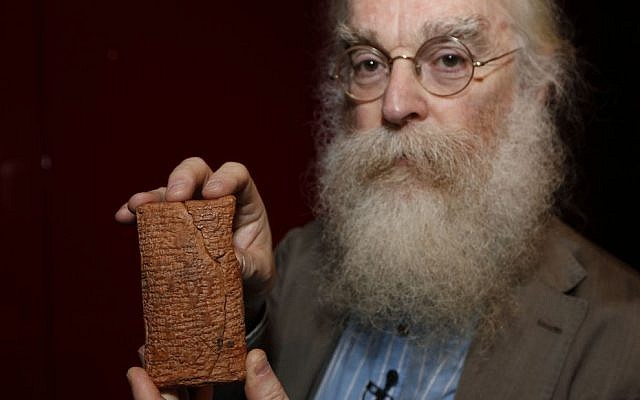 Irving Finkel, curator in charge of cuneiform clay tablets at the British Museum, poses with the 4000 year old clay tablet containing the story of the Ark and the flood during the launch of his book 'The Ark Before Noah' at the British Museum in London, Friday, Jan. 24, 2014. The book tells how he decoded the story of the Flood and offers a new understanding of the Old Testament's central narratives and how the flood story entered into it. (photo credit: AP/Sang Tan)