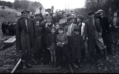 The former inmates, who were transported by train from Bergen-Belsen, were photographed in Farsleben, Germany, shortly after their liberation by US troops on Apr. 13, 1945. (United States Holocaust Memorial Museum, courtesy of George Gross)