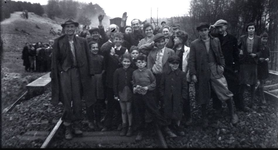 The former inmates who were transported by train from Bergen-Belsen were photographed in Farsleben, Germany, shortly after their liberation by U.S. troops on Apr. 13, 1945. (United States Holocaust Memorial Museum, courtesy of George Gross)