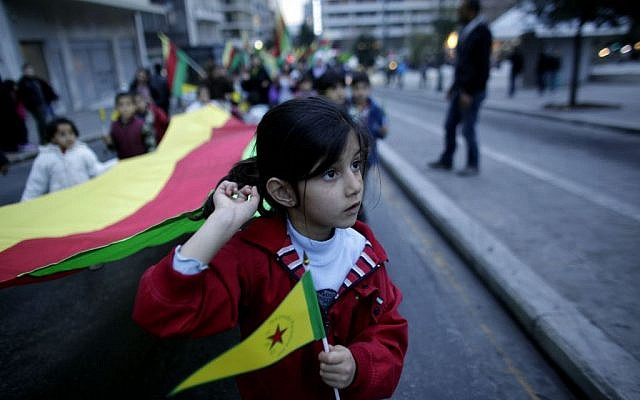 A girl holds a Kurdish flag during a protest in Athens on Saturday, Jan. 18 2014. (photo credit: AP/Kostas Tsironis)