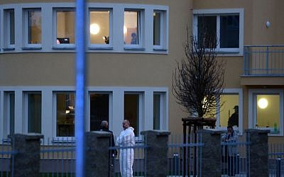 Investigators outside the residence of Palestinian ambassador to the Czech Republic, Jamel al-Jamal, who died after an explosion in his diplomatic residence in Prague on  January 1, 2014. (AP/CTK, Katerina Sulova)