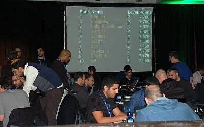 Illustrative photo of hackers in Tel Aviv taking part in a hackathon to develop cyber-security apps (Courtesy)