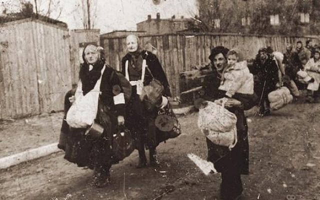 Illustrative photo of Lodz Ghetto residents, who head toward the trains that will take them to Chelmno extermination camp, in Poland (photo credit: unknown)