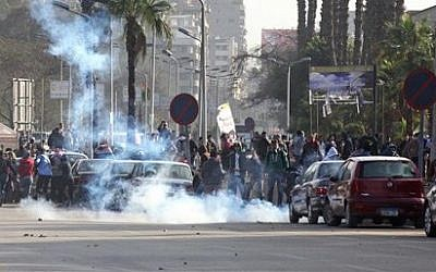 Supporters of ousted leader Mohammed Morsi clash with security forces in Nahda Square, near Cairo University in Giza, Egypt, Sunday, Jan. 12, 2014 (photo credit: AP /Mohammed Abu Zaid)