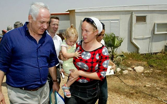 Benjamin Netanyahu, then leader of the opposition, visits a West Bank settlement outpost in 2007 (Photo credit: Olivier Fitoussi /Flash90)