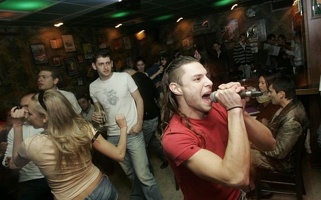 Young Immigrants from Russia sing and dance at a Karaoke evening at the Putin Bar in Jerusalem (Photo credit: Anna Kaplan/ Flash90)