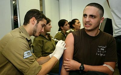 Illustrative photo: An Israeli recruit receives an injection (Photo credit: Moshe Shai/FLASH90)