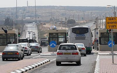 Illustrative photo of Israeli cars driving through a checkpoint on Route 443 in the West Bank (Gili Yaari/Flash90)