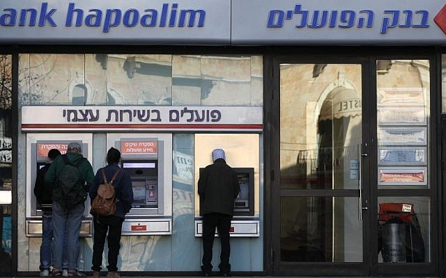 Jerusalemites take out money from an ATM (photo credit: Nati Shohat/Flash90)