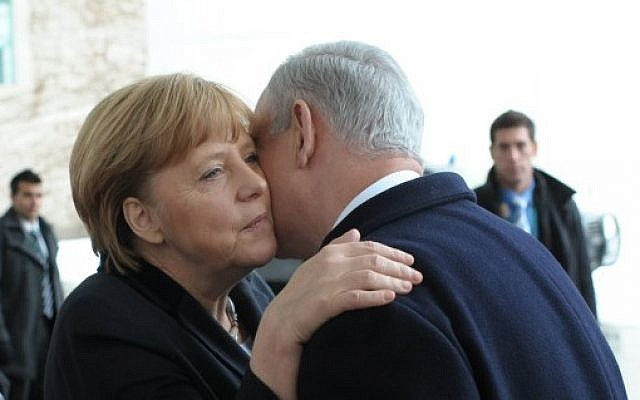 German Chancellor Angela Merkel and Israeli Prime Minister Benjamin Netanyahu embrace after attending a joint press conference in Berlin, Germany. on December 6, 2012. (photo credit: Amos Ben Gershom/GPO/Flash90)