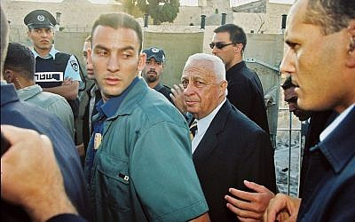 Then opposition leader Ariel Sharon seen at the Mugrabi Gate en route  to the Temple Mount, on 28 September 2000. Sharon visited with an escort of over 1,000 police officers. The Second Intifada erupted soon after. (photo credit: Flash90)